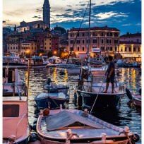 Man on a boat in front of Rovinj